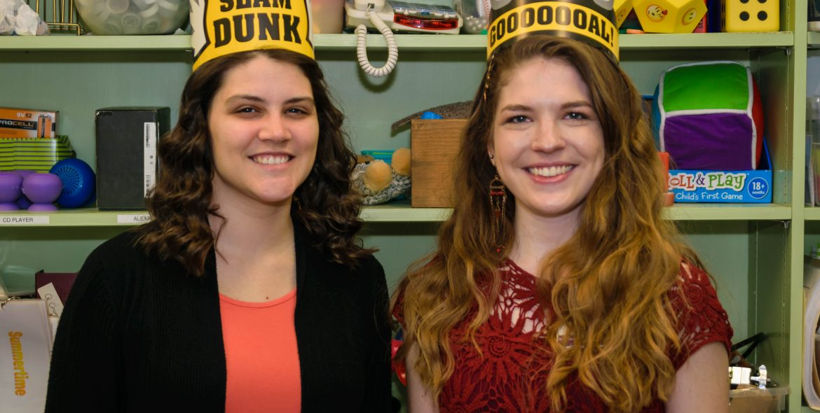 two young women wearing buffalo wild wings crowns