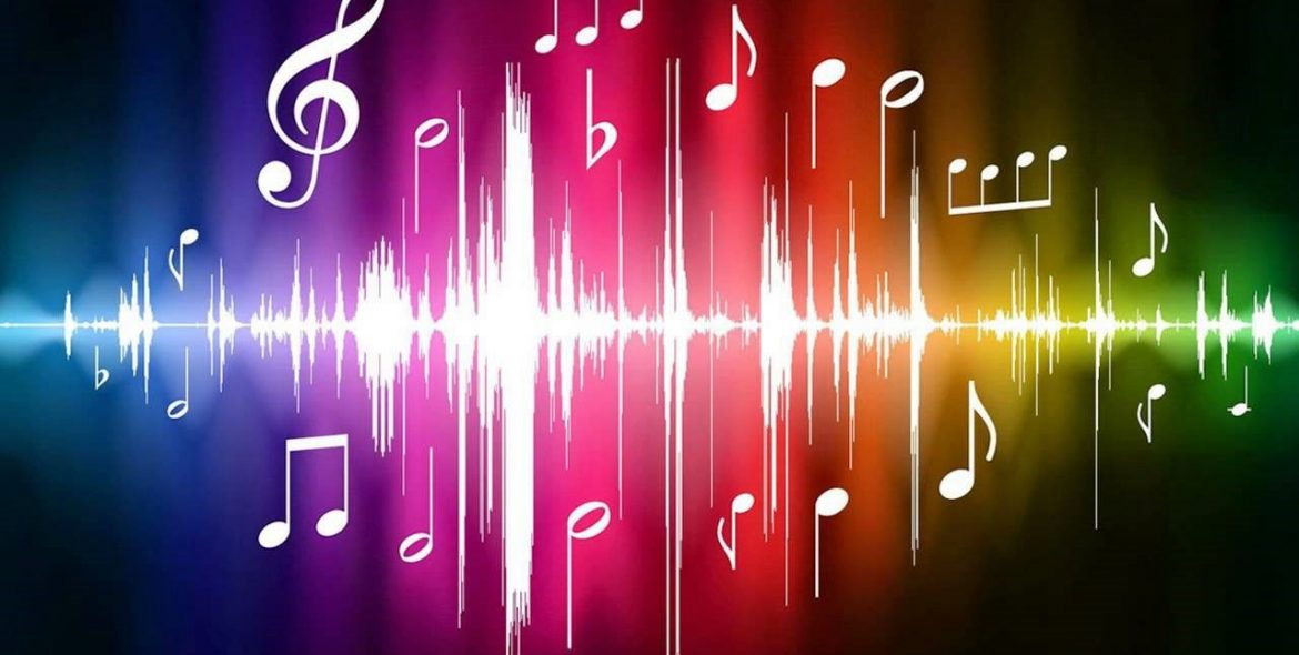 Color spectrum background, overlay with sound frequency wave and music notes/symbols in white.