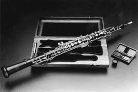 a black and whtie picture of an oboe sitting on top of its' case