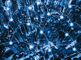 Black and Blue city image with dots marking different building and lines connecting the digital netwrok connections happening between the different buildings.