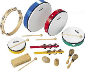 A variety of percussion instruments sitting with a white background.