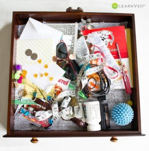 A drawer that is filled with random things you would find around your house (sunglasses, measuring tape, screwdriver, paper, medicine, etc.)